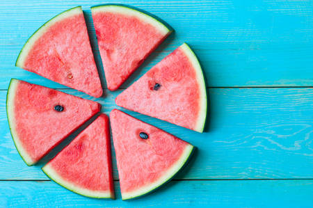 Slice of Watermelon on blue wooden background