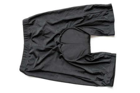 Black bike shorts isolated on white background