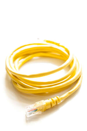 Yellow lan cable isolated on white background
