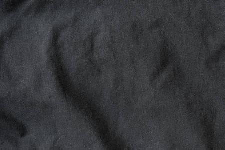 Black crease cloth texture background