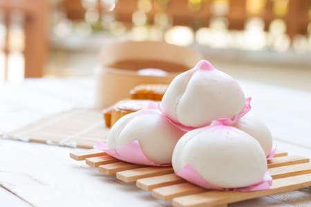 Peach shaped steam bun Stockfoto
