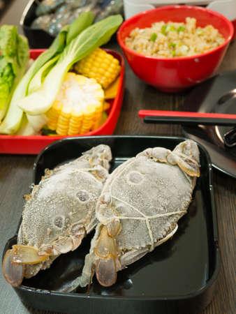 Crab with vegetable and garlic rice at shabu shabu restaurant