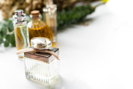 Perfume in bottles with eucalyptus leaves