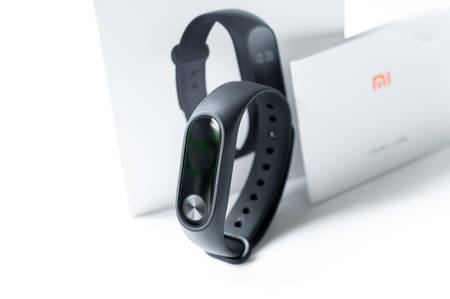 Ayutthaya, Thailand - july 24, 2018: Xiaomi Mi band 2, fitness band for tracking activity and heartrate monitor Editorial