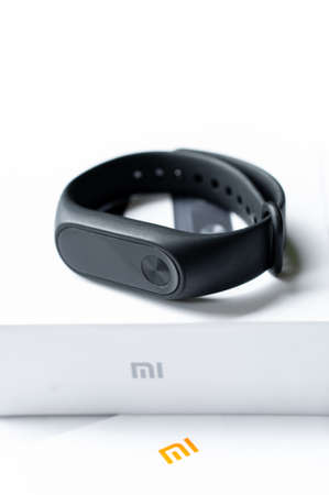 Ayutthaya, Thailand - july 24, 2018: Xiaomi Mi band 2, fitness band for tracking activity and heartrate monitor Фото со стока