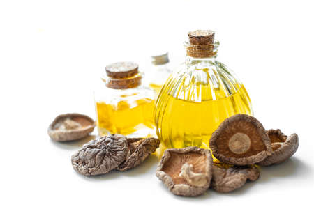 Mushroom and olive oil isolated on white