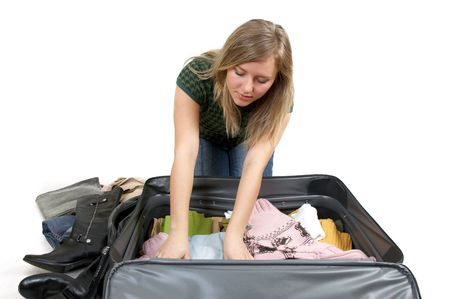 girl is packing clothes, separate on white Stock Photo