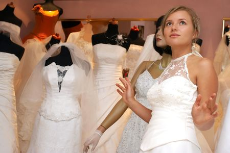 young woman in white dress as a mannequin