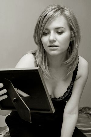mention:  pretty woman is looking at photograph, black and white photo