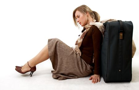 beauty woman with huge bag is siting, separate on white