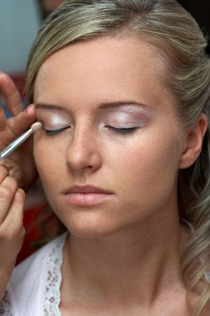Somebody makes young beauliful woman make-up