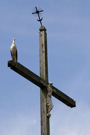jesus standing: the stork is standing on cross