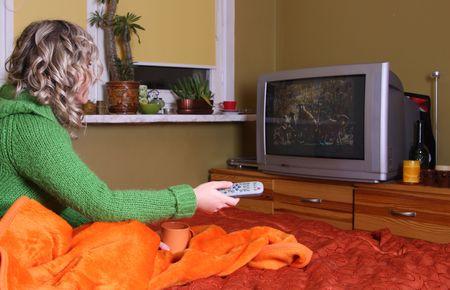 girl is watching tv Stock Photo