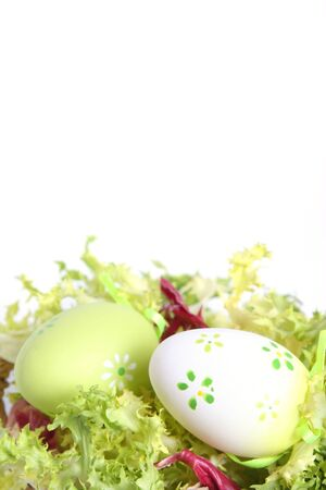 easter eggs in salad separate on white Stock Photo