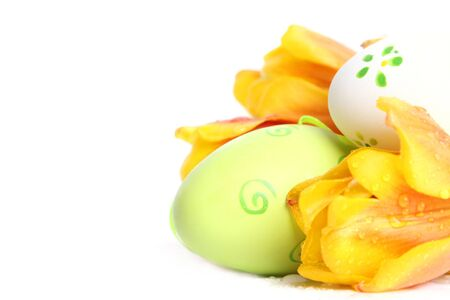 green easter eggs with orange tulips photo
