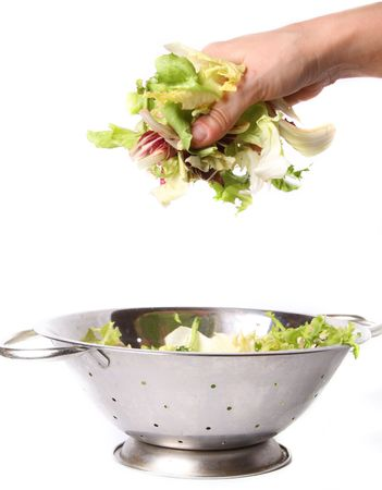 salad in hand separate on white