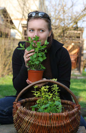 sniffing: woman is sniffing herbs