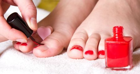 red nail polish on her foot fingers Stock Photo