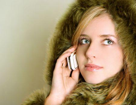 winter woman is talking on phone photo