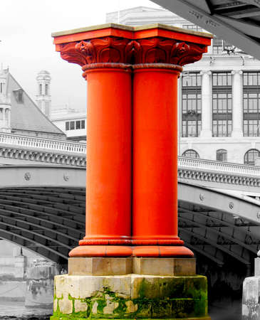 Red pillar on River Thames