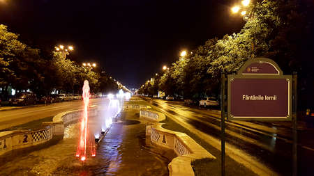 Night view at colorful fountain in Bucharest, Romania. Stock Photo