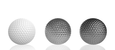 three golf balls on line of different materials, on a reflective surface