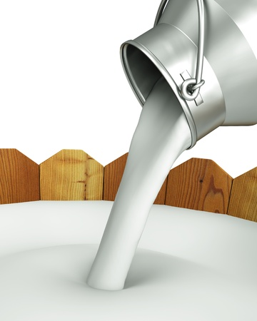 milk pail: Pour the milk into the wooden container  Stock Photo