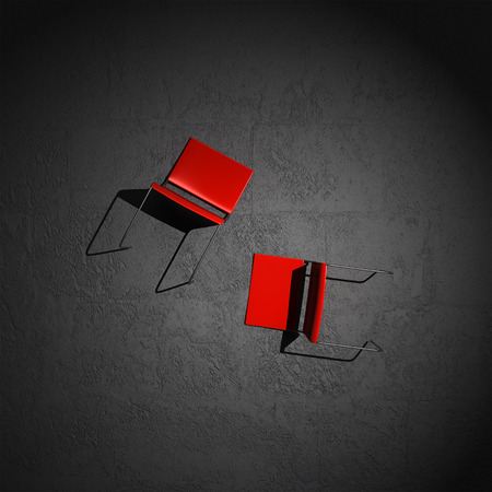 overthrown: chairs stretched out on the floor Stock Photo