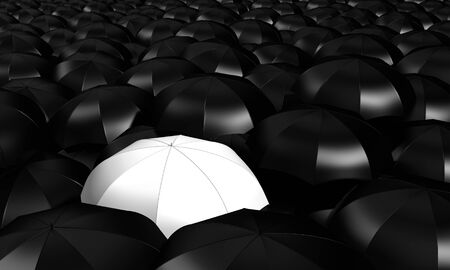 a white umbrella between many other blacks