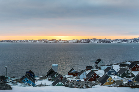 nuuk: Sunset and colorful arctic houses at the Nuuk fjord, Nuuk Greenland