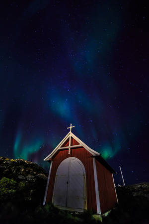 nuuk: Northern lights over the small chapel, nearby Nuuk, October 2015 Stock Photo