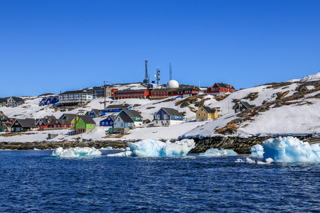 nuuk: Drifting icebergs along Nuuk city, Greenlandic capital Nuuk Stock Photo
