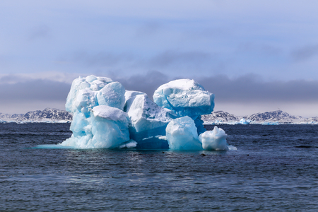 nuuk: Huge drifting iceberg, view from old harbor in Nuuk city, Greenland Stock Photo