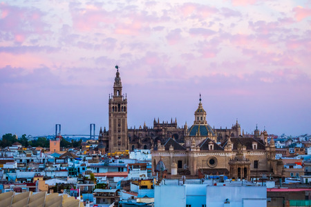 metropol parasol: Sunset in Seville, view from Metropol Parasol at the old Cathedral, Seville,Spain