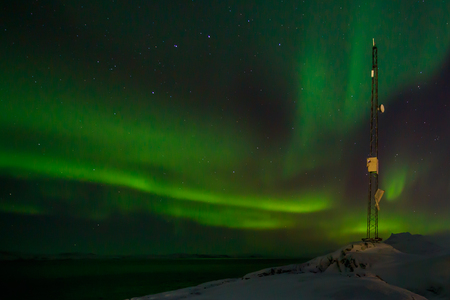nuuk: Communication tower and northern lights with a fjord in the background, Nuuk, Greenland