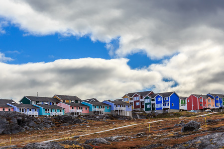 greenlandic: Colorful cottages in the suburb of Nuuk city, Greenland Stock Photo