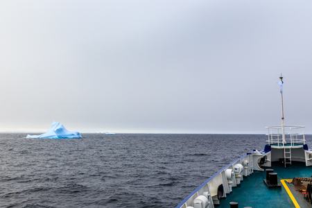 ship bow: Ship bow and Iceberg drifting at Lemaire Channel, Antarctica