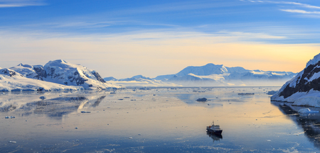 Neco bay surrounded by glaciers and cruise vessel drifting slowly, Antarctic