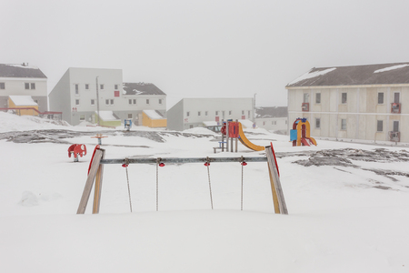 nuuk: Harsh greenlandic childhood,playground covered in snow and ice in Nuuk city, Greenland