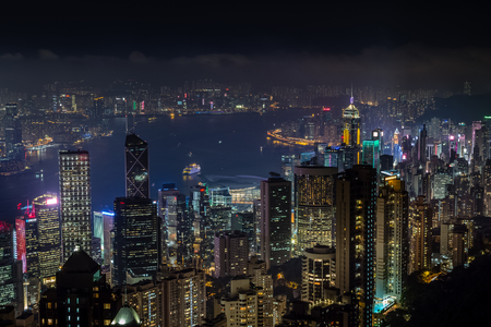 Aerial night view from Victoria peak to Kowloon bay and skyscrapers of Hong Kong island, China republic