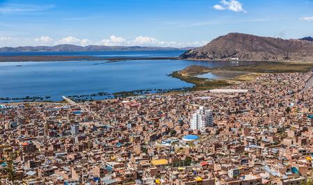 Peruvian city Puno and lake Titicaca panorama, Peru