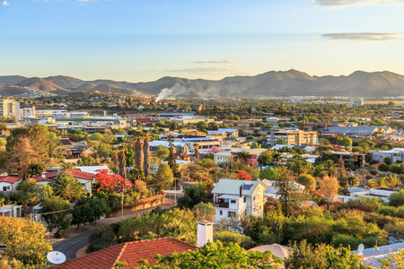 Windhoek rich resedential area quarters on the hills with mountains in the background, Windhoek, Namibia Banco de Imagens - 88708725