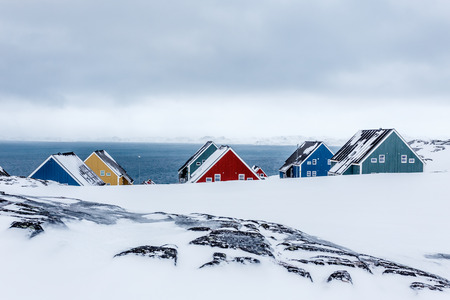 Rows of colorful inuit houses among rocks in a suburb of arctic capital Nuuk, Greenland