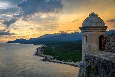 San Pedro de La roca fort walls and tower, sunset view with sea and Carribean coastline, Santiago De Cuba, Cuba