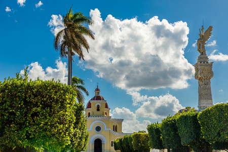 Cristobal colon catholic cemetery chapel and column with angel in the foreground, Vedado, Havana, Cuba Stock Photo