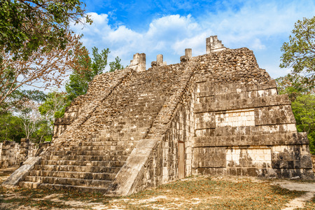 Small mayan pyramid in the forest, Chichen Itza archaeological site, Yucatan, Mexico