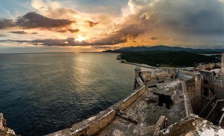 San Pedro de La Roca fort walls with canon, Carribean sea sunset view, Santiago De Cuba, Cuba