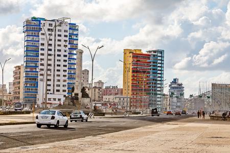 Modern resedential buildings close to Malecon promenade and road with cars, Vedado, Havana, Cuba
