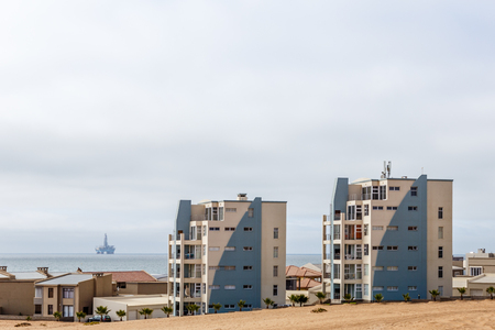 Modern houses of Dolfynstrand resort at the seaside, close to Walvis Bay, Namibia Editorial