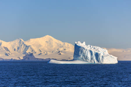 Huge blue iceberg drifting across the sea at Lemaire Channel, Antarctica 写真素材